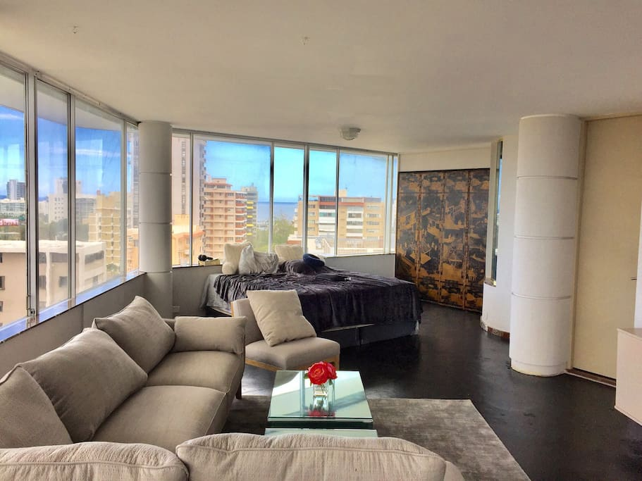 2nd floor of Penthouse 850 square feet with 2 beds. 1 king and 1 queen. Room divides into 2 with privacy drapes.