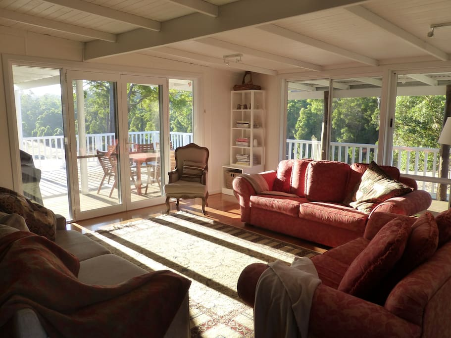Spacious living room, complete with comfy couches, TV, books, magazines and bean bags for all to enjoy. Leads out to the expansive deck with divine views..... relaxation at its best!