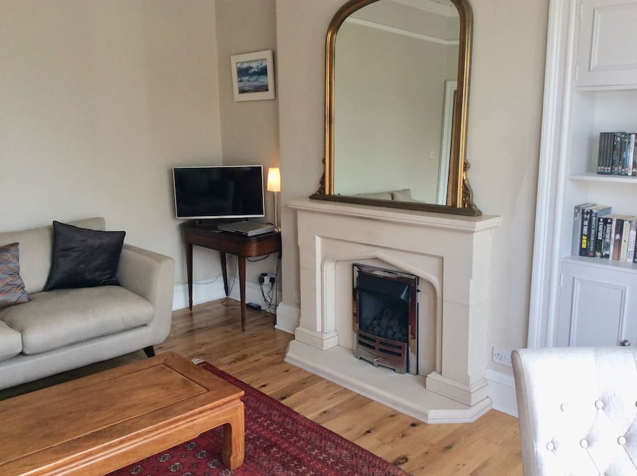 Lovely bright sitting room with gas fire, tv and DVD player