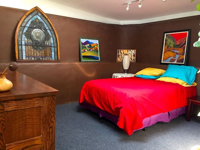 The Earthship's colorful & comforting bedroom nestled in the back.