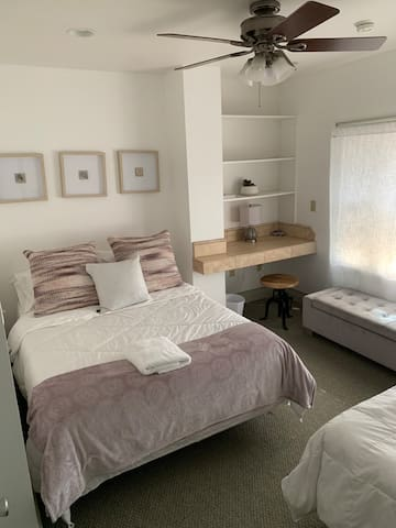 First floor bedroom with  Queen bed with single bed