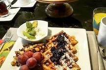 Belgian waffles and blueberry coulis.