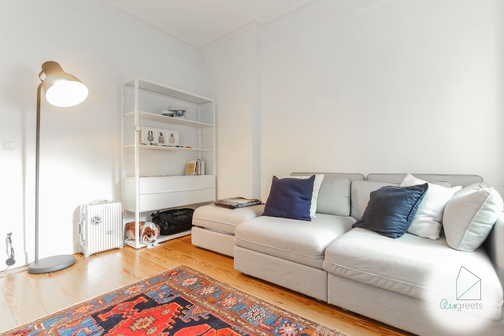 The living room is also very bright & has a comfy couch where you can relax after a busy day in the city.