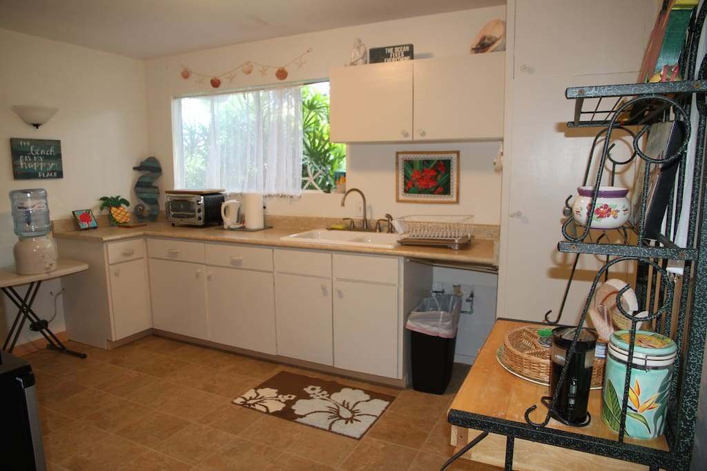 separate kitchen fully stocked with cooking and eating utensils