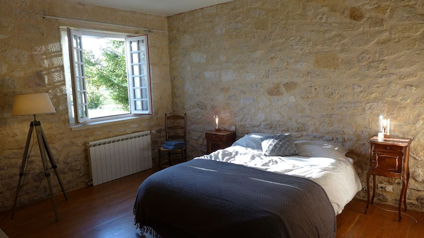 Bedroom one is a beautiful, spacious room with stunning views out over the garden and the vineyards beyond