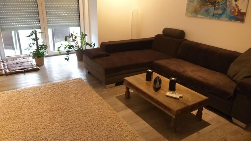 Moderne EG Wohnung mit Garten