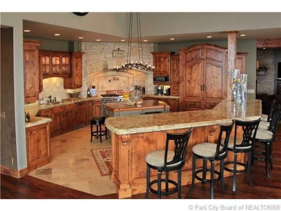 Fully Stocked kitchen with Wolf appliances, Subzero refrigerator/freezer, wine/beer refrigerator, lovely lighting