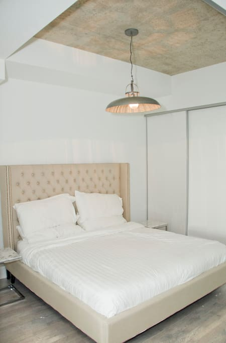Spacious and comfortable king size bed with marble side tables