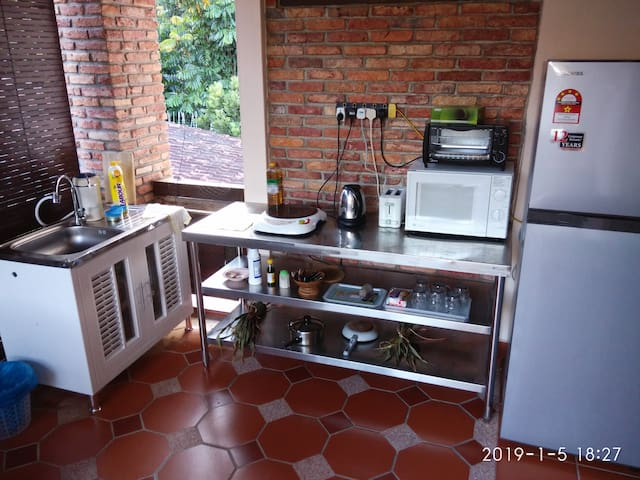 Balcony, Fridge, microwave, oven, toaster, eletric kettle, stove and utilities for light cooking.