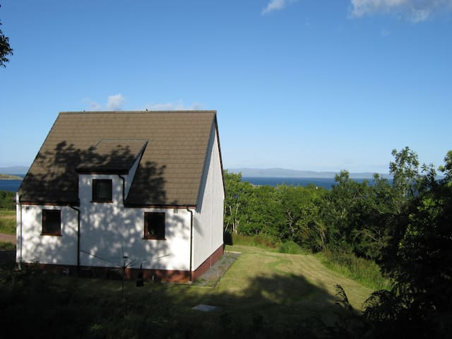 The cottage overlooks the sea.