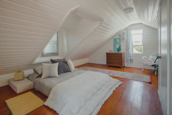 Upstairs guest bedroom with queen-size bed.  A queen-sized air mattress is also available and fits comfortably in the space.