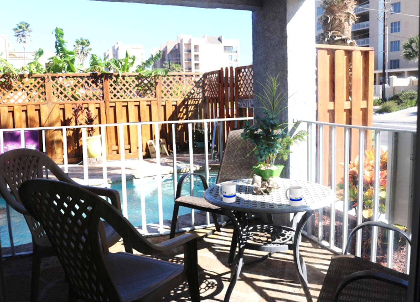 Enjoy a cup of morning coffee while overlooking the pool and Gulf Blvd.