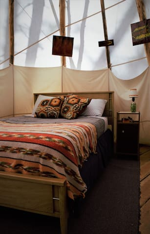 Get a good night's rest in the full-size bed. The tipi is decorated with custom local art from our good friend.