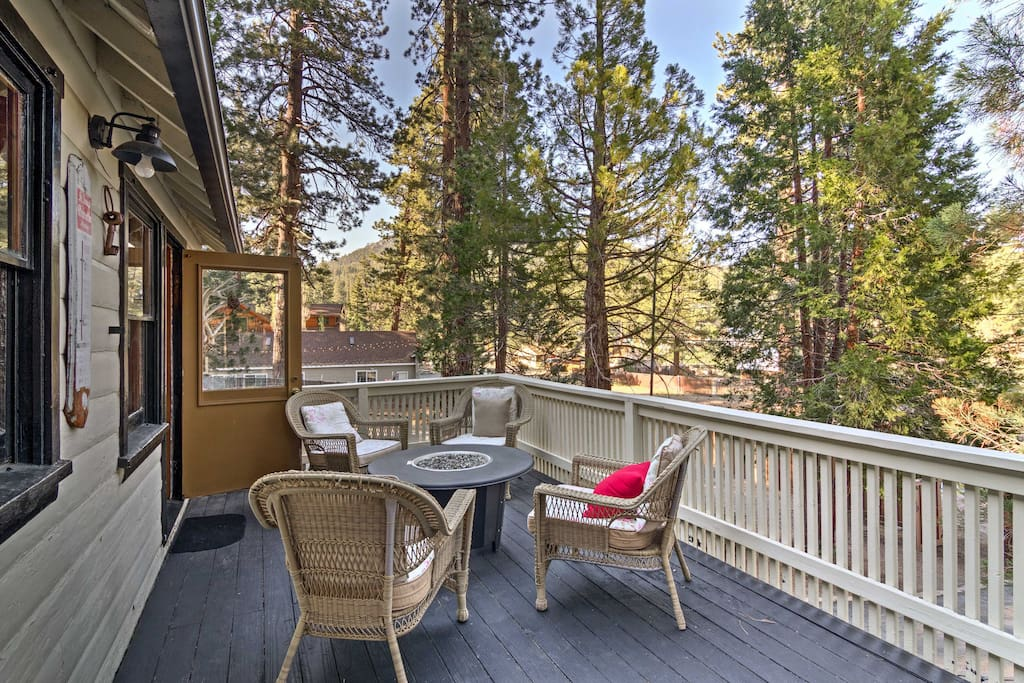 Enjoy the sprawling forest views with friends and family from this private deck.