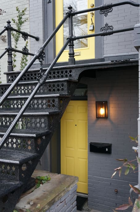 Front door of English basement apartment - owners/hosts live upstairs