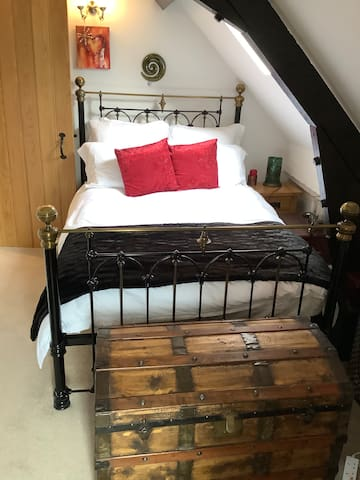 """Relax and sleep well on this standard double """"Laura Ashley"""" wrought iron bed.  A firm Hypnos mattress will hopefully help to give you that perfect nights sleep. All linen is 100% Egyptian cotton and is sent away to be professionally laundered !"""