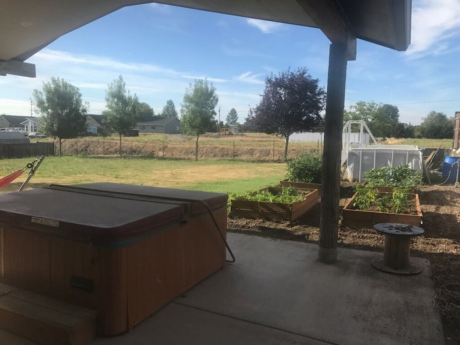 Hot tub and garden - many veggies to choose from.