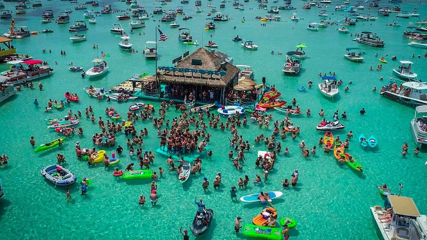 Listen to a local band play on a floating stage; grab a frito-pie at a swim-up restaurant; or just let the kids catch hermit crabs all day.  Crab Island is a Destin icon and local favorite for good reason.  And it's only a mile from Mojo!
