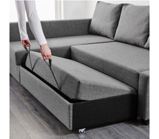 Comfortable corner sofa can turn into bed.