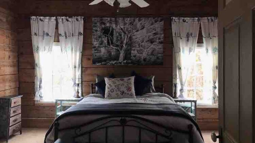 Master bedroom with custom art and antiques