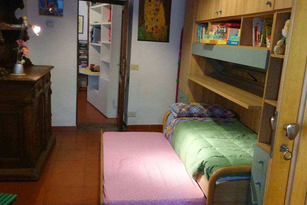 Compact unit includes 2 single beds and a pull out bed as well as storage.