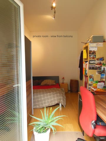 private sleeping room with desk and exit to the balcony