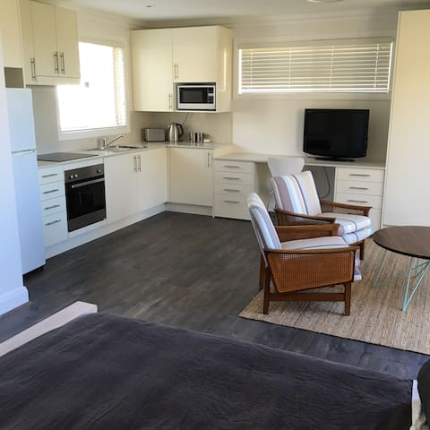 kitchen with full oven, fridge and microwave