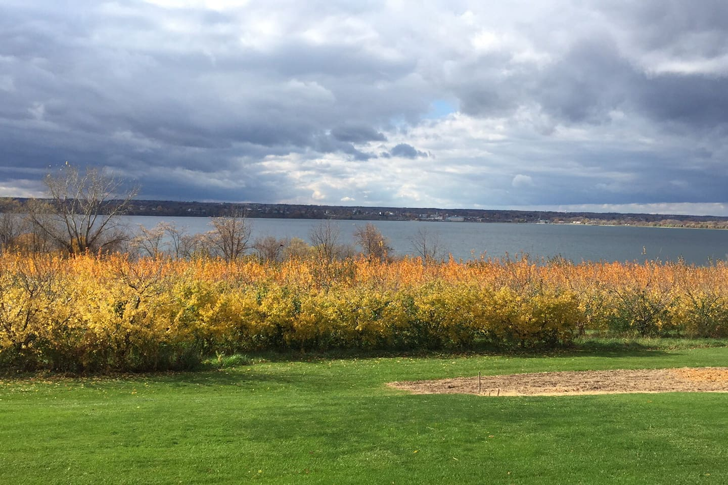 Best airbnbs in Rotorua for families featured by top family travel blogger, Marcie in Mommyland: Back view of house with beautiful Seneca Lake view