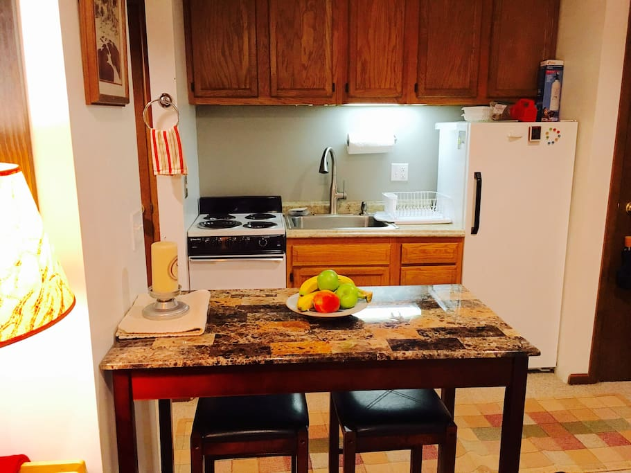 Kitchen with all you need to prepare your meals! Fridge, microwave, stove, coffee maker and all of the cookware!