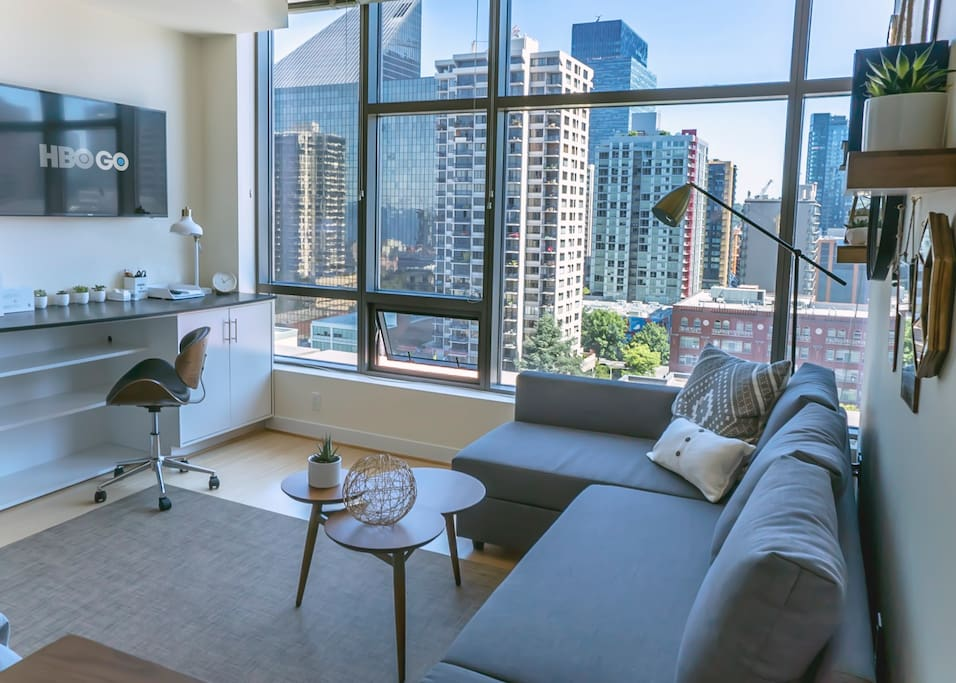 Modern bright studio with contemporary accents throughout.