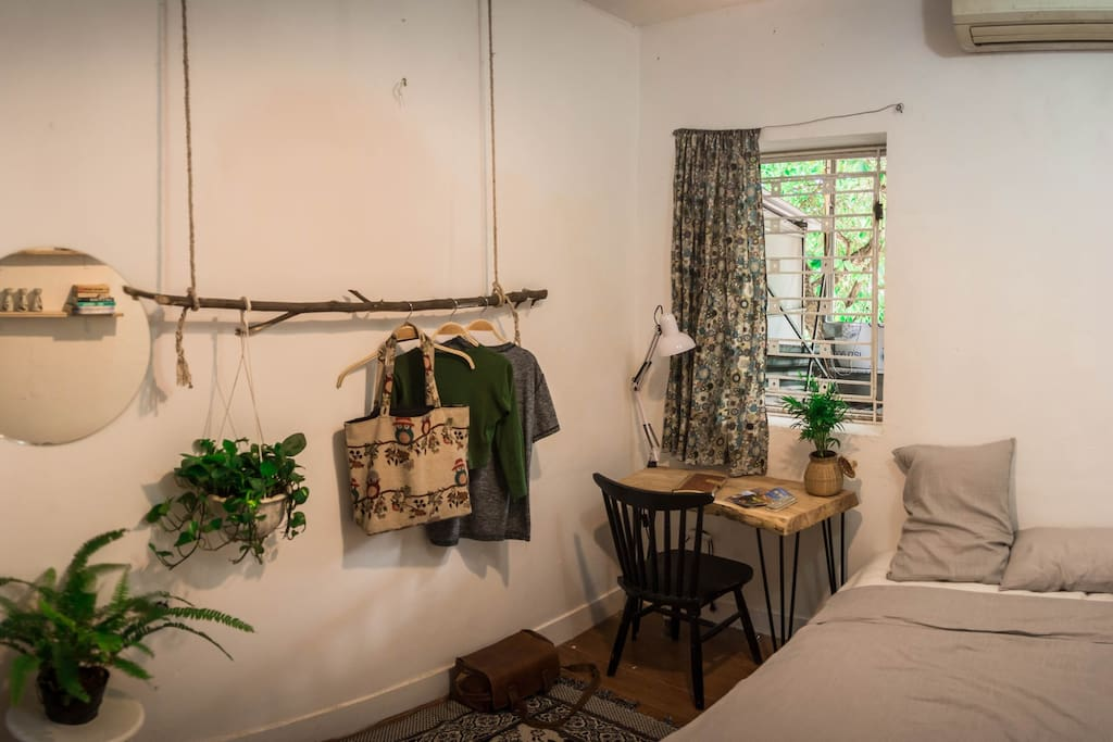Lovely bedroom with full of cute and stylish stuffs and furniture - a corner where you enjoy your stay at the fullest as a local. Wide window right down to main street of Hang Giay