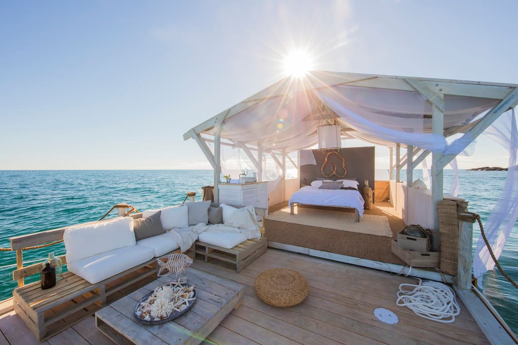 Wake up at sunrise and feel the sway of your ocean home.