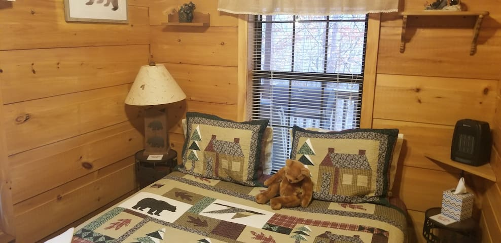 The bear themed bedroom has a queen bed.  It is slighty smaller of the two bedrooms but is super cute and comfy.  Quilts/bedding designs change often.