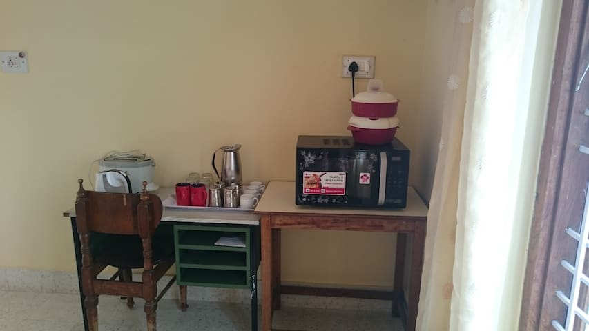 Kitchen space to make your own tea/coffee and toast. if not interested to make your own, a few steps out of the gate you can find Indian veg cafe and Burger  Joint with non veg  items.