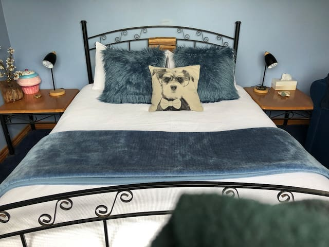 Lovely comfortable queen sized bed upstairs.