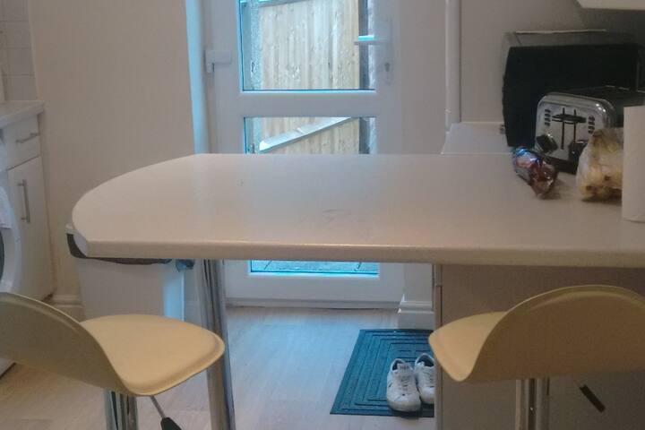 Large, Bright, Modern, Clean kitchen with breakfast bar.