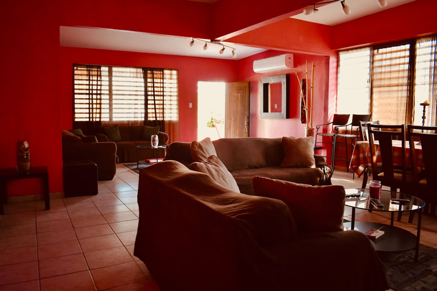 Huge living room: 2 sofas, 2 love seats, stools, TV, cable TV, kitchen table with 6 chairs, air conditioning, ottoman, tables