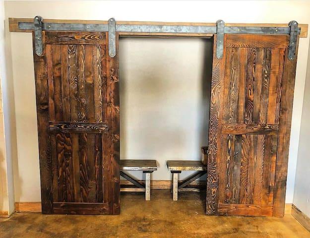 Look at these beautiful barn wood sliding closet doors!