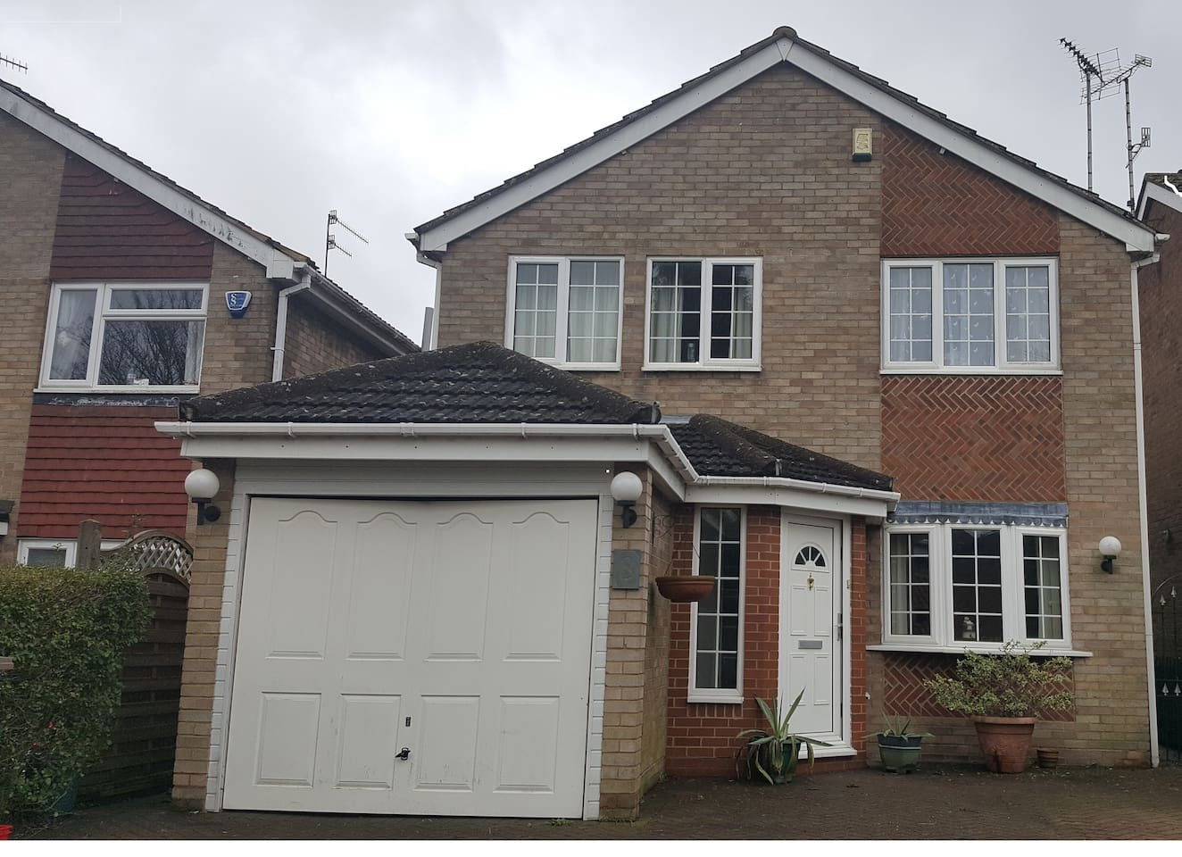Front of the delightful detached House with free parking