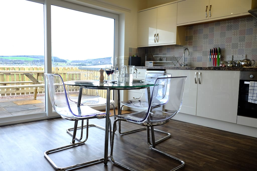 Open plan kitchen-diner with views of Caledonian Canal, Kessock Bridge and Beauly Firth