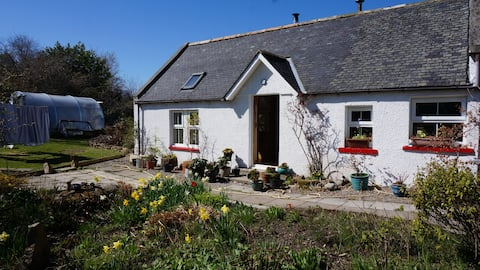 Traditional highland cottage set in small village
