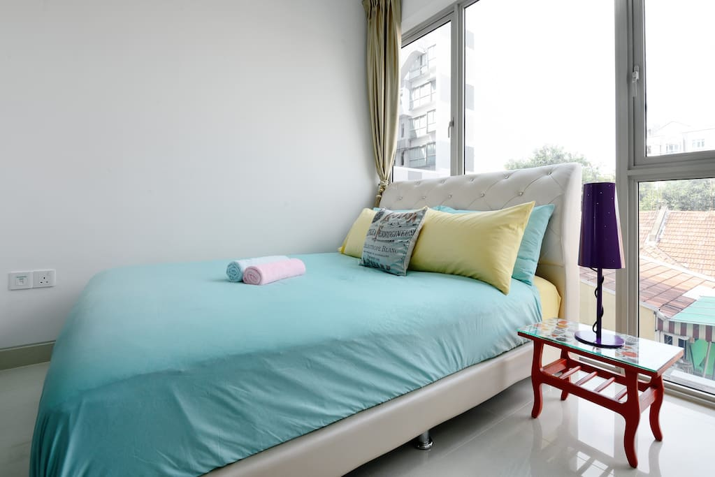 Premium bedding covered with topper and room has black out curtains and privacy curtains