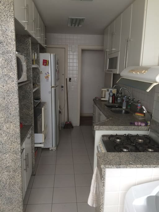 Complete kitchen with microwave, oven, refrigerator, dishwasher.