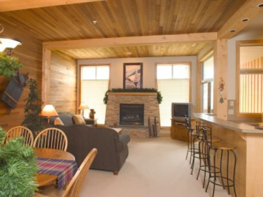 Main living area - cozy gas fireplace, flat screen TV.