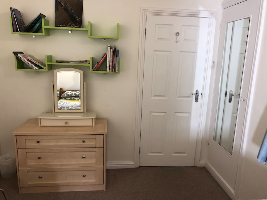 Double bedroom: twin single beds  Lime green book case