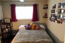 Bedroom #2 has a queen bed, desk and Apple TV.