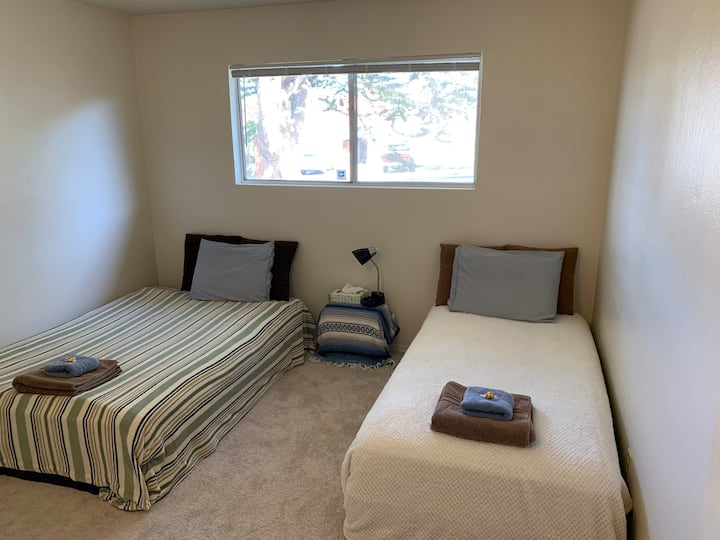 Cozy Room: (Patio View) Full Bed and Twin Bed