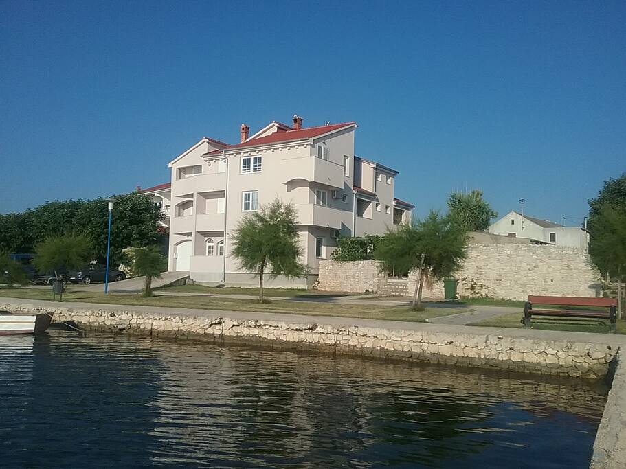 The apartments are located in the house next to the sea