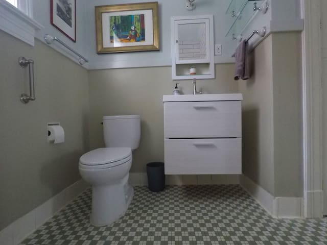 Full Bath with Tub/Shower. Just renovated but Original tile floor and classic tub incorporated.