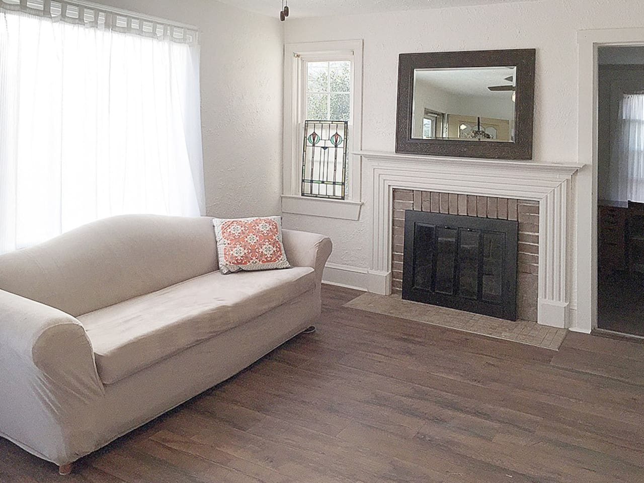 """Living Room, plenty of filtered light pours in through the picture window. Gather to watch your favorite show on the 42"""" smart TV. Not a sofa sleeper but a young one can sleep comfortably on top."""